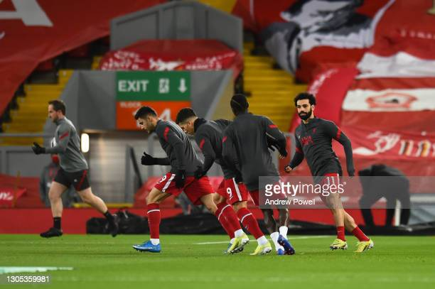 Sadio Mane of Liverpool with Mohamed Salah of Liverpool before the Premier League match between Liverpool and Chelsea at Anfield on March 04, 2021 in...