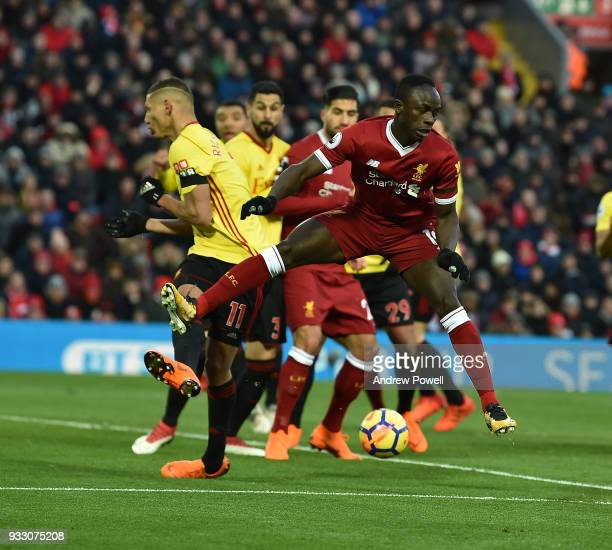 Sadio Mane of Liverpool with Richarlison of Watford during the Premier League match between Liverpool and Watford at Anfield on March 17 2018 in...