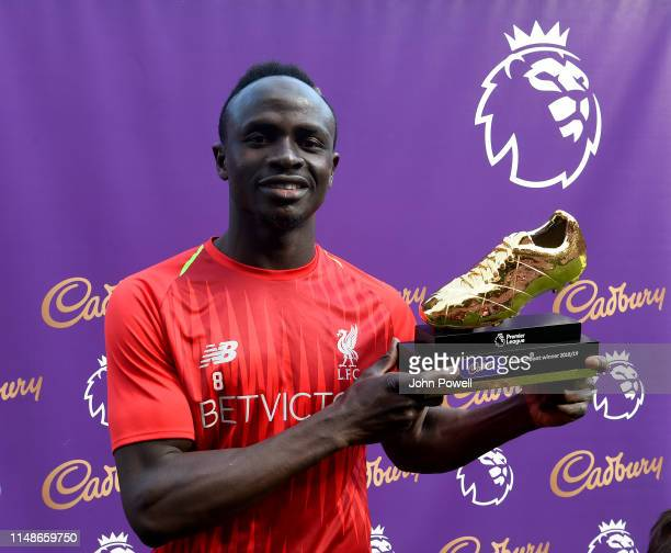Sadio Mane of Liverpool with the golden boot at the end of the Premier League match between Liverpool FC and Wolverhampton Wanderers at Anfield on...