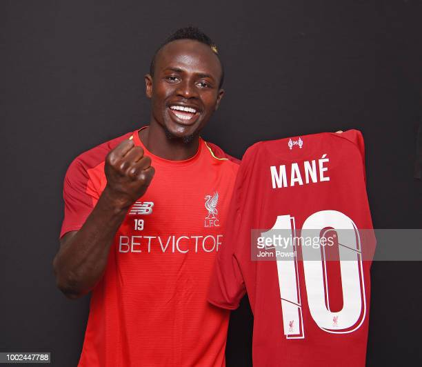 Sadio Mane of Liverpool with the new number 10 shirt at Melwood Training Ground on July 20 2018 in Liverpool England