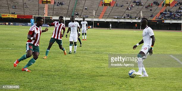 Sadio Mane of Senegal and Barence Ristu of Burundi vie for the ball during the 2017 Africa Cup of Nations qualification Group K game between Senegal...