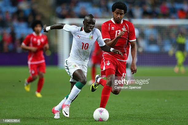 Sadio Mane of Senegal and Khamis Esmaeel of United Arab Emirates contest the ball during the Men's Football first round Group D Match between Senegal...