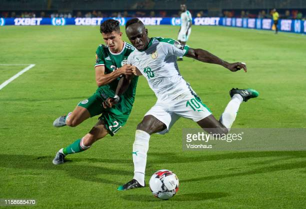Sadio Mane of Senegal and Youcef Atal of Algeria during the 2019 Africa Cup of Nations Group C match between Senegal and Algeria at 30th June Stadium...