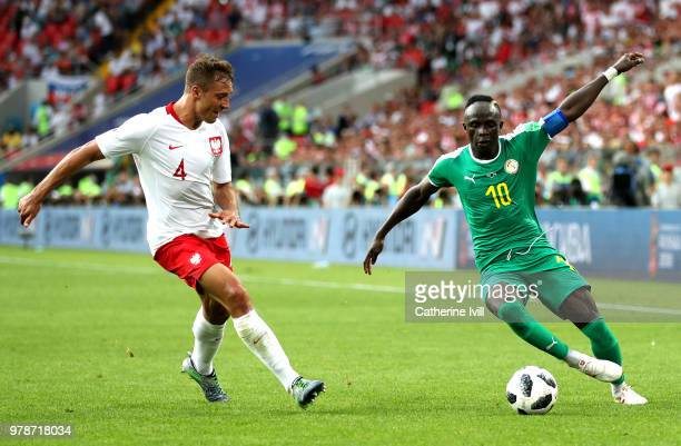 Sadio Mane of Senegal challenge for the ball with Thiago Cionek of Poland during the 2018 FIFA World Cup Russia group H match between Poland and...