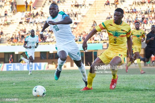 Sadio Mane of Senegal fights for the ball with Dibassi Bakaye of Mali during a friendly match between Senegal and Mali after both teams qualified for...