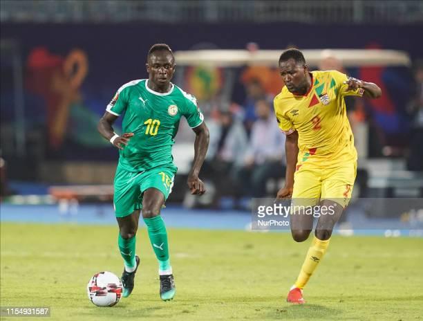 Sadio Mane of Senegal followed by Enock Sabumukama of Burundi during the 2019 African Cup of Nations match between Senegal and Benin at the 30 June...