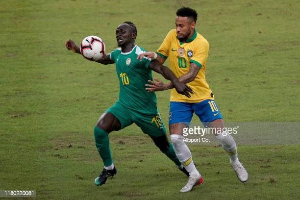 Sadio Mane of Senegal holds off Neymar of Brazil during the international friendly match between Brazil and Senegal at the Singapore National Stadium...