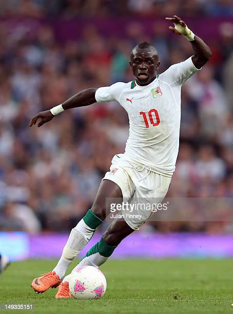 Sadio Mane of Senegal in action during the Men's Football first round Group A Match of the London 2012 Olympic Games between Great Britain and...