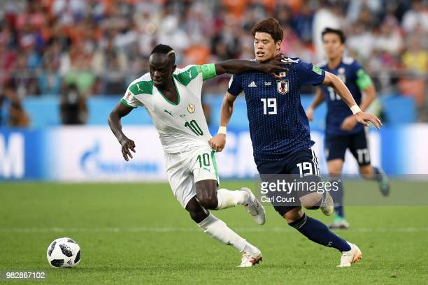 Sadio Mane of Senegal is challenged by Hiroki Sakai of Japan during the 2018 FIFA World Cup Russia group H match between Japan and Senegal at...