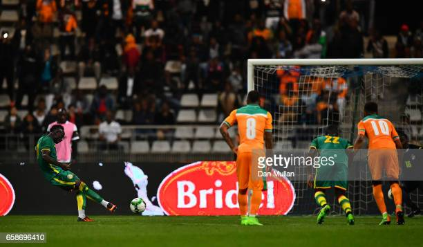 Sadio Mane of Senegal scores his side's first goal from the penalty spot during the International Friendly match between the Ivory Coast and Senegal...