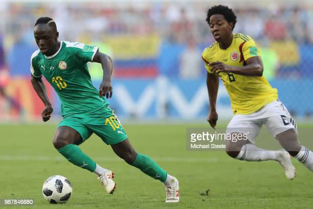 Sadio Mane of Senegal tracked by Carlos Sanchez of Colombia during the 2018 FIFA World Cup Russia group H match between Senegal and Colombia at...