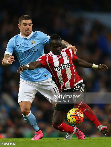 Sadio Mane of Southampton and Aleksandar Kolarov of Manchester City compete for the ball during the Barclays Premier League match between Manchester...