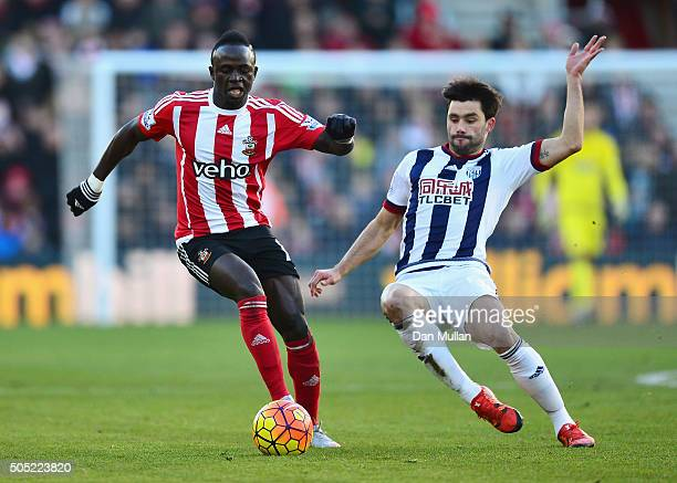 Sadio Mane of Southampton and Claudio Yacob of West Bromwich Albion compete for the ball during the Barclays Premier League match between Southampton...