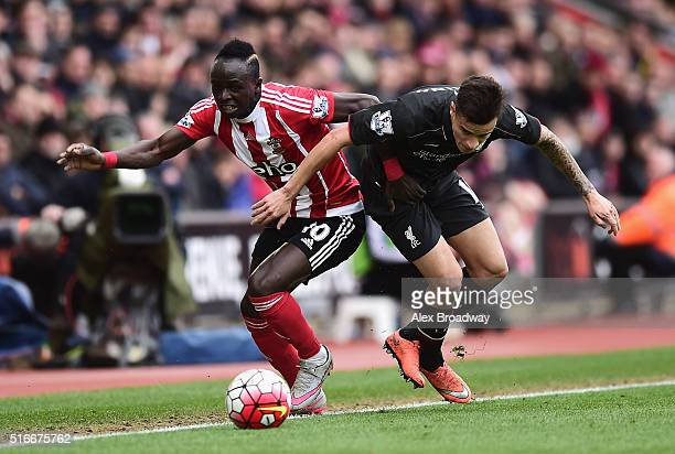 Sadio Mane of Southampton and Philippe Coutinho of Liverpool battle for the ball during the Barclays Premier League match between Southampton and...