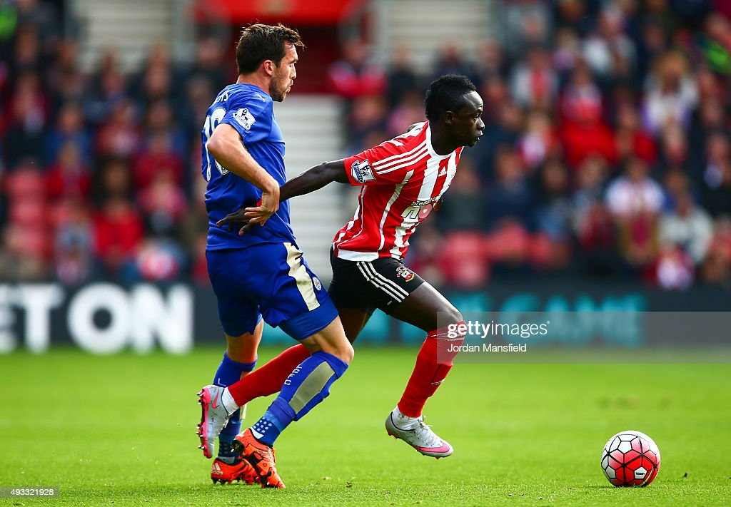 Sadio Mane of Southampton avoids a tackle from Christian Fuchs of Leicester during the Barclays Premier League match between Southampton and Leicester City at St Mary's Stadium on October 17, 2015 in Southampton, England.