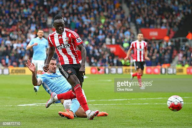 Sadio Mane of Southampton beats Aleksandar Kolarov of Manchester City as he scores his third goal and his team's fourth during the Barclays Premier...