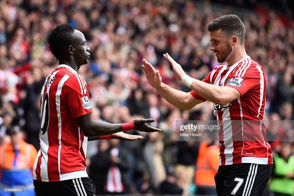 Sadio Mane (L) of Southampton celebrates scoring his team's second goal with Shane Long during the Barclays Premier League match between Southampton and Manchester City at St Mary's Stadium on May 1, 2016 in Southampton, England.