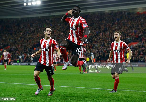 Sadio Mane of Southampton celebrates with team mates as he scores their first goal with a header during the Capital One Cup quarter final match...