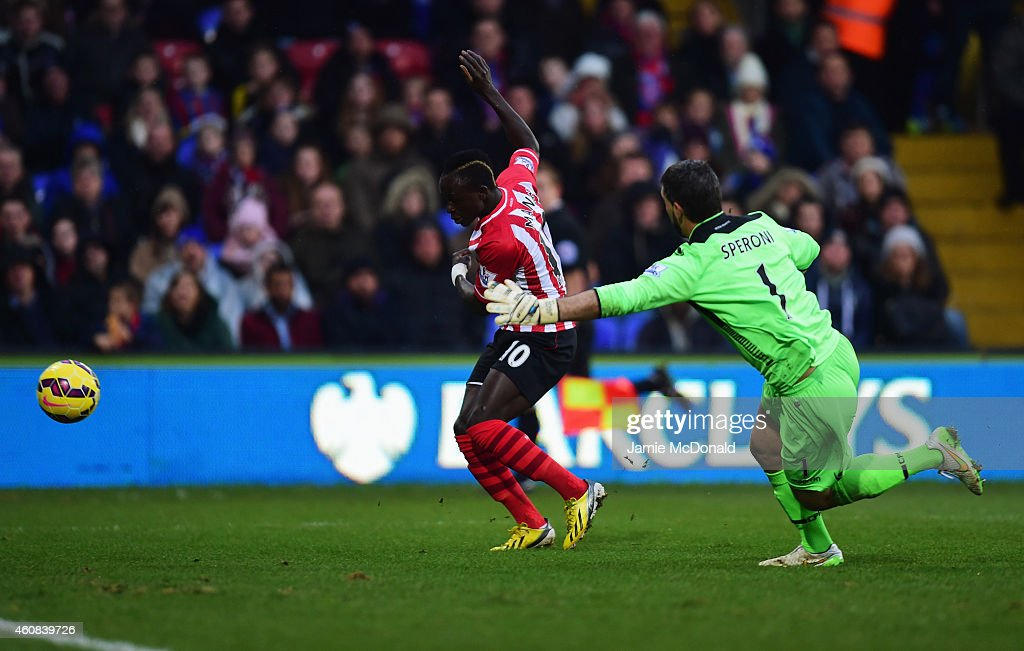 Sadio Mane of Southampton evades goalkeeper Julian Speroni of Crystal Palace to score their first goal during the Barclays Premier League match between Crystal Palace and Southampton at Selhurst Park on December 26, 2014 in London, England.
