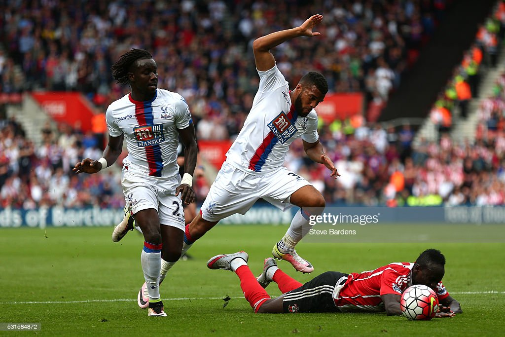 Sadio Mane of Southampton is brought down by Adrian Mariappa of Crystal Palace resulting in the penalty during the Barclays Premier League match between Southampton and Crystal Palace at St Mary's Stadium on May 15, 2016 in Southampton, England.