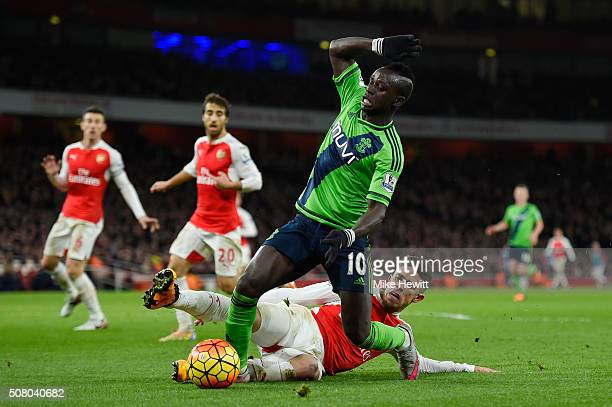 Sadio Mane of Southampton is challenged by Gabriel of Arsenal during the Barclays Premier League match between Arsenal and Southampton at the...
