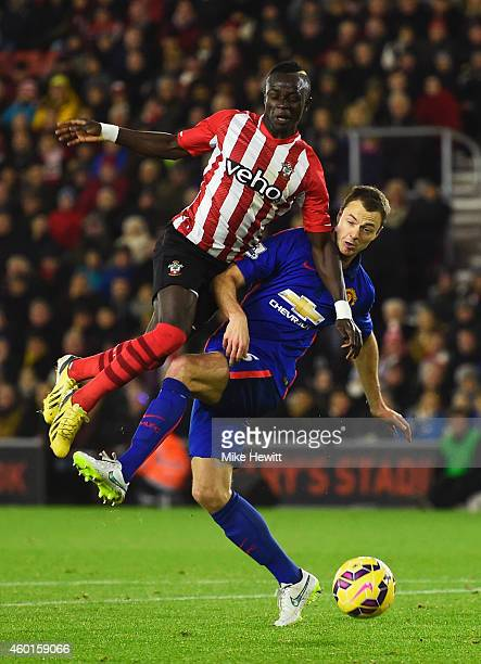 Sadio Mane of Southampton is challenged by Jonny Evans of Manchester United during the Barclays Premier League match between Southampton and...