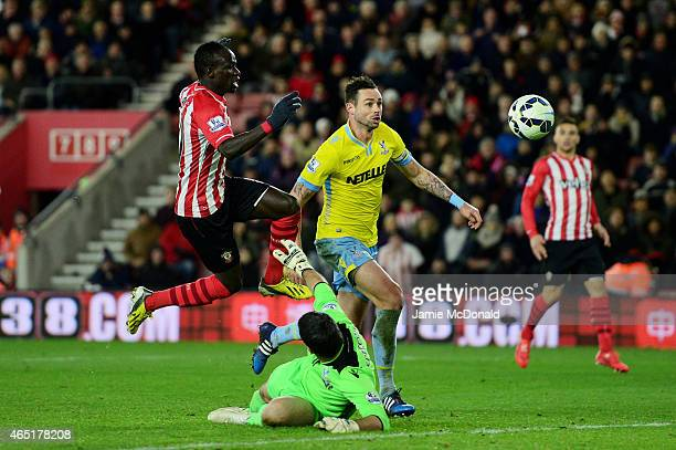 Sadio Mane of Southampton lifts the ball over goalkeeper Julian Speroni of Crystal Palace to score the opening goal during the Barclays Premier...