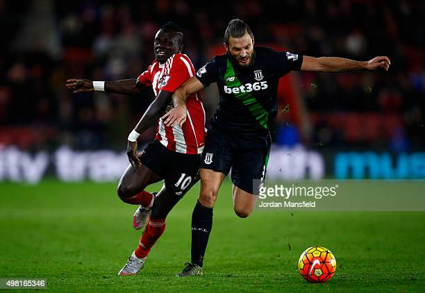 Sadio Mane of Southampton tackles with Erik Pieters of Stoke during the Barclays Premier League match between Southampton and Stoke City at St Mary's...