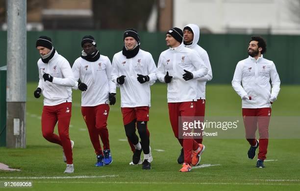 Sadio Mane Roberto Firmino Loris Karius Mohamed Salah Dejan Lovren Joel Matip and Jordan Henderson of Liverpool during a training session at Melwood...