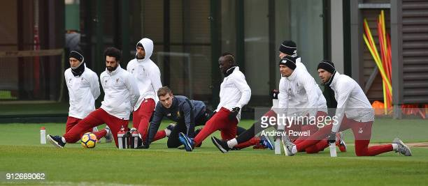 Sadio Mane Roberto Firmino Loris Karius Mohamed Salah Dejan Lovren Joel Matip and Jordan Henderson of Liverpool during a training session at Melwood...