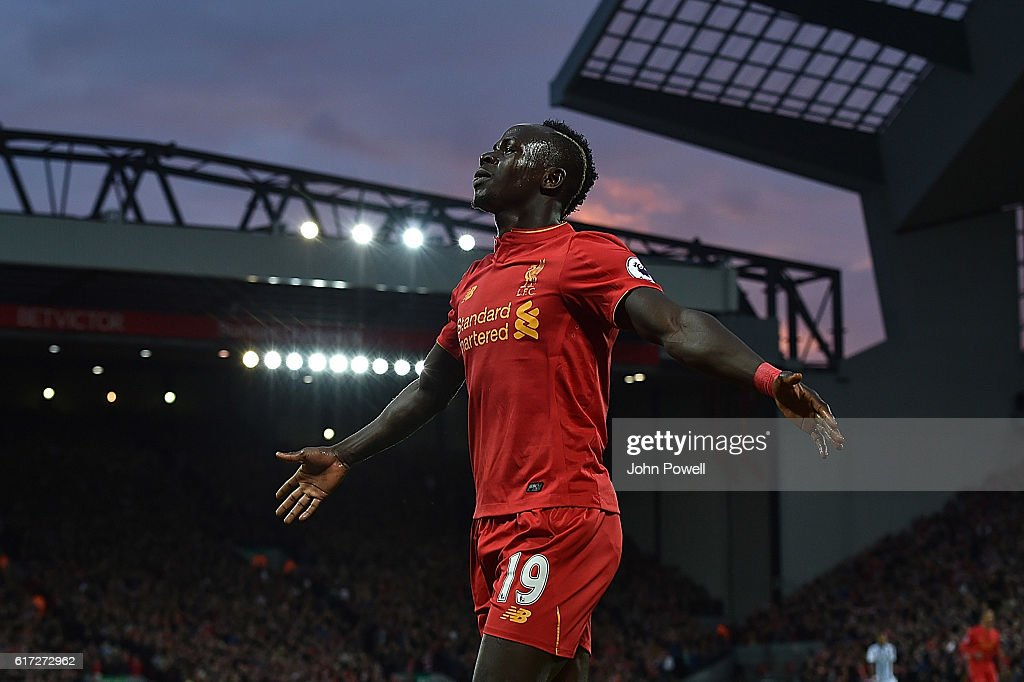 Sadio Mane Scores Liverpools Opener and celebrates during the Premier League match between Liverpool and West Bromwich Albion at Anfield on October 22, 2016 in Liverpool, England.