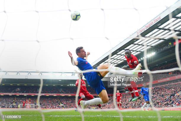 Sadio Mane scores the first goal during the Premier League match between Liverpool FC and Chelsea FC at Anfield on April 14, 2019 in Liverpool,...