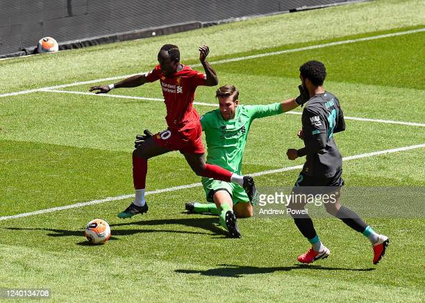 Sadio Mane scoring a goal past Adrian of Liverpool during a training session at Anfield on June 01 2020 in Liverpool England