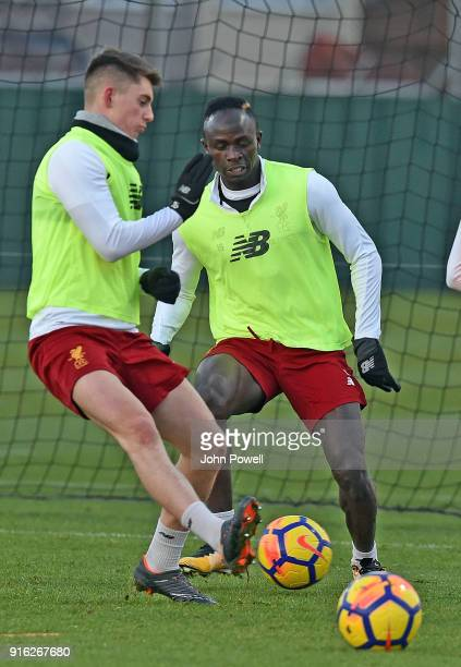 LIVERPOOL ENGLAND FEBRUARY 09 Sadio Mane with Ben Woodburn of Liverpool during a training session at Melwood Training Ground on February 9 2018 in...