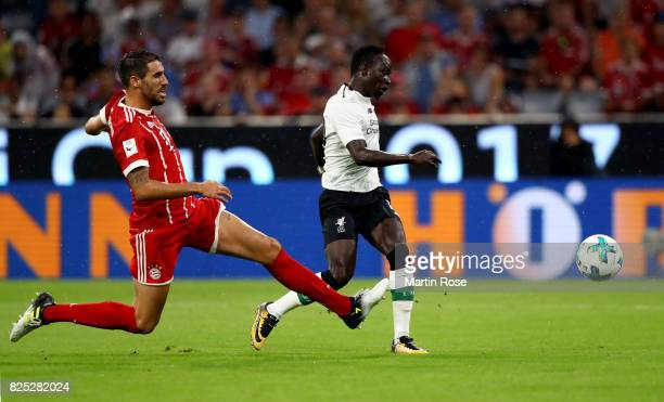 Sadio Sane of Liverpool is scoring the opening goal during the Audi Cup 2017 match between Bayern Muenchen and Liverpool FC at Allianz Arena on...