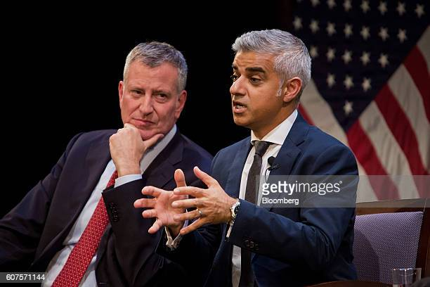 Sadiq Khan, mayor of London, right, speaks as Bill de Blasio, mayor of New York City, listens during a forum with at LaGuardia Community College in...
