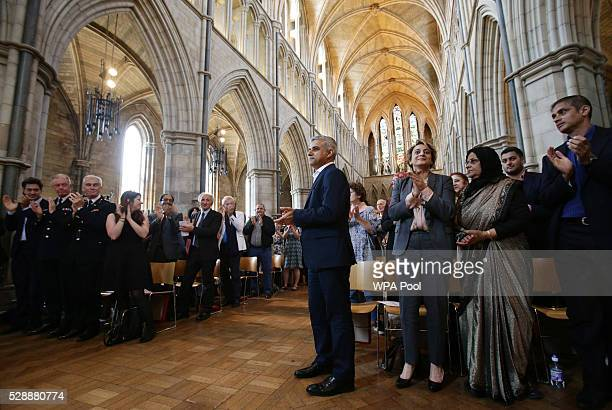 Sadiq Khan receives a standing ovation during an official signing ceremony at Southwark Cathedral as he begins his first day as newly elected Mayor...