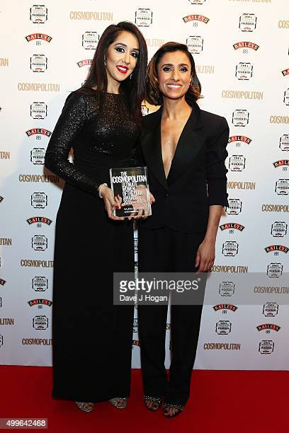 Sadja Mughal and Anita Rani pose for a photo with the award for Humanitarian during the Cosmopolitan Ultimate Women Of The Year Awards at One Mayfair...