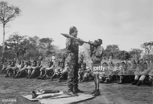 Sadjunjira Mozambique A young boy is shown how to handle a rocket launcher at a Mozambican National Resistance guerillas' recruit training camp at...