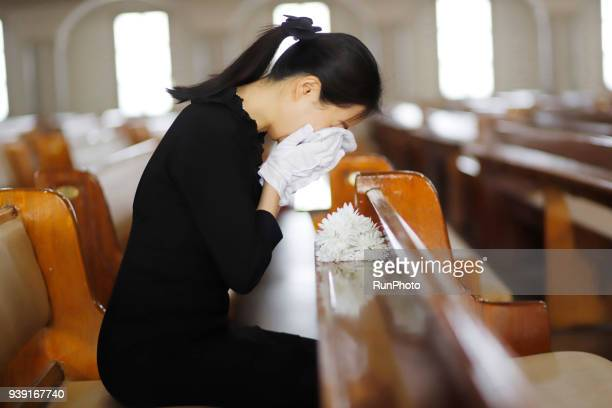 sadness bereaved mourning at funeral - rest in peace stock photos and pictures