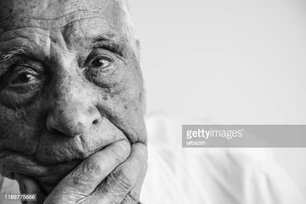 sadness in the eyes - dementia stock pictures, royalty-free photos & images