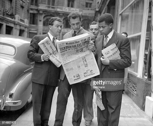Sadness lining their faces, Frenchmen read the headlines of a Paris paper announcing the fall on the Indochina fortress of Dien Bien Phu, 5/7....