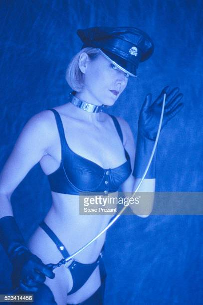 sadomasochistic woman with whip - riding crop stock photos and pictures
