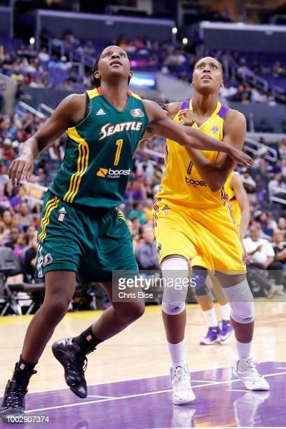 Sadrine Gruda of the Los Angeles Sparks and Crystal Langhorne of the Seattle Storm are photographed during the game between the two teams on August...