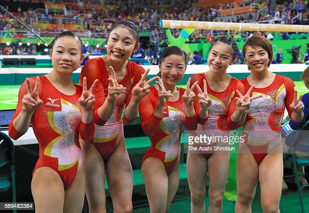 Sae Miyakawa Yuki Uchiyama Asuka Teramoto Aiko Sugihara and Mai Murakami of Japan pose for photographs after competing in the Artistic Gymnastics...