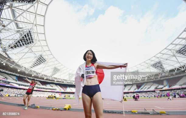 Sae Tsuji of Japan poses for a photo after finishing in third place in the women's 400meter T47 final of the World Para Athletics Championships in...