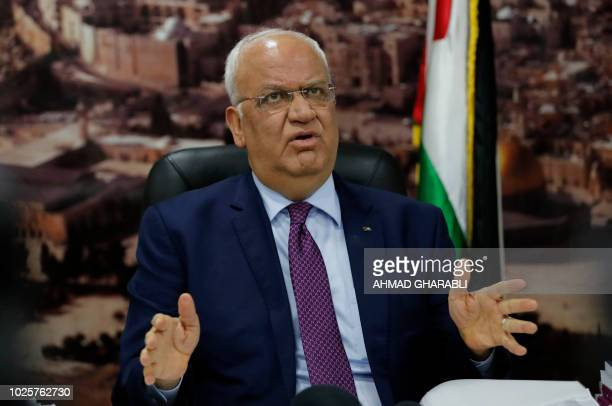 Saeb Erekat secretary general of the Palestine Liberation Organisation speaks to journalists in the West Bank city of Ramallah on September 1 2018...