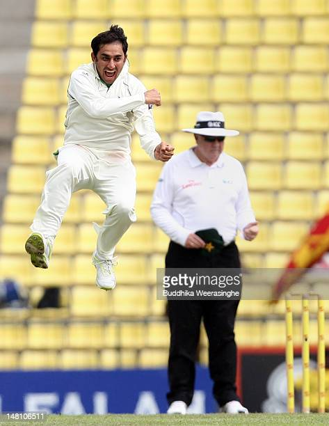 Saeed Ajmal of Pakistan celebrates after taking the wicket of Sri Lankan batsman Tharanga Paranavitana as umpire Steve Davis looks on during day...