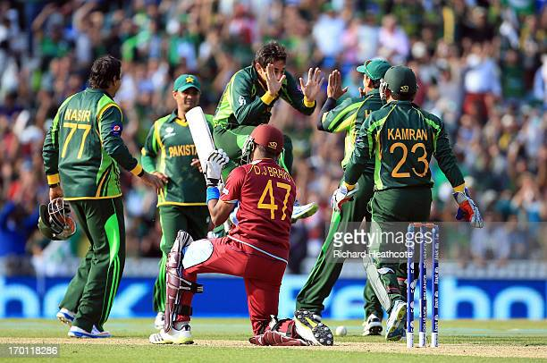 Saeed Ajmal of Pakistan celebrates taking the wicket of Dwyane Bravo of West Indies during the ICC Champions Trophy group B match between West Indies...