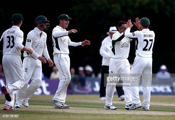 Saeed Ajmal of Worcestershire celebrates with team mate Daryl Mitchell after taking the wicket of Nicholas Gubbins of Middlesex during day three of...